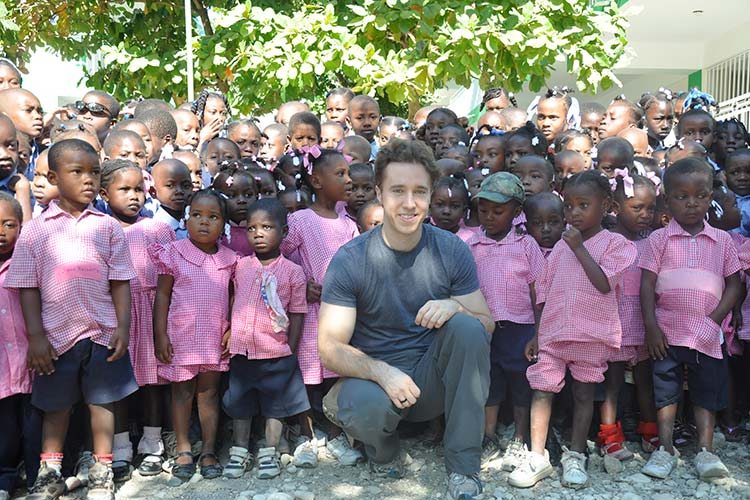 Craig Kielburger and children in Africa