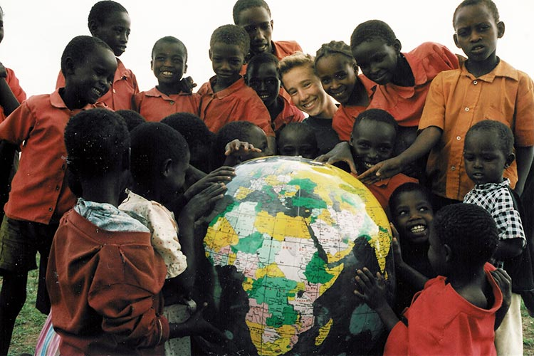 Craig Kielburger with children in Africa with a huge globe ball